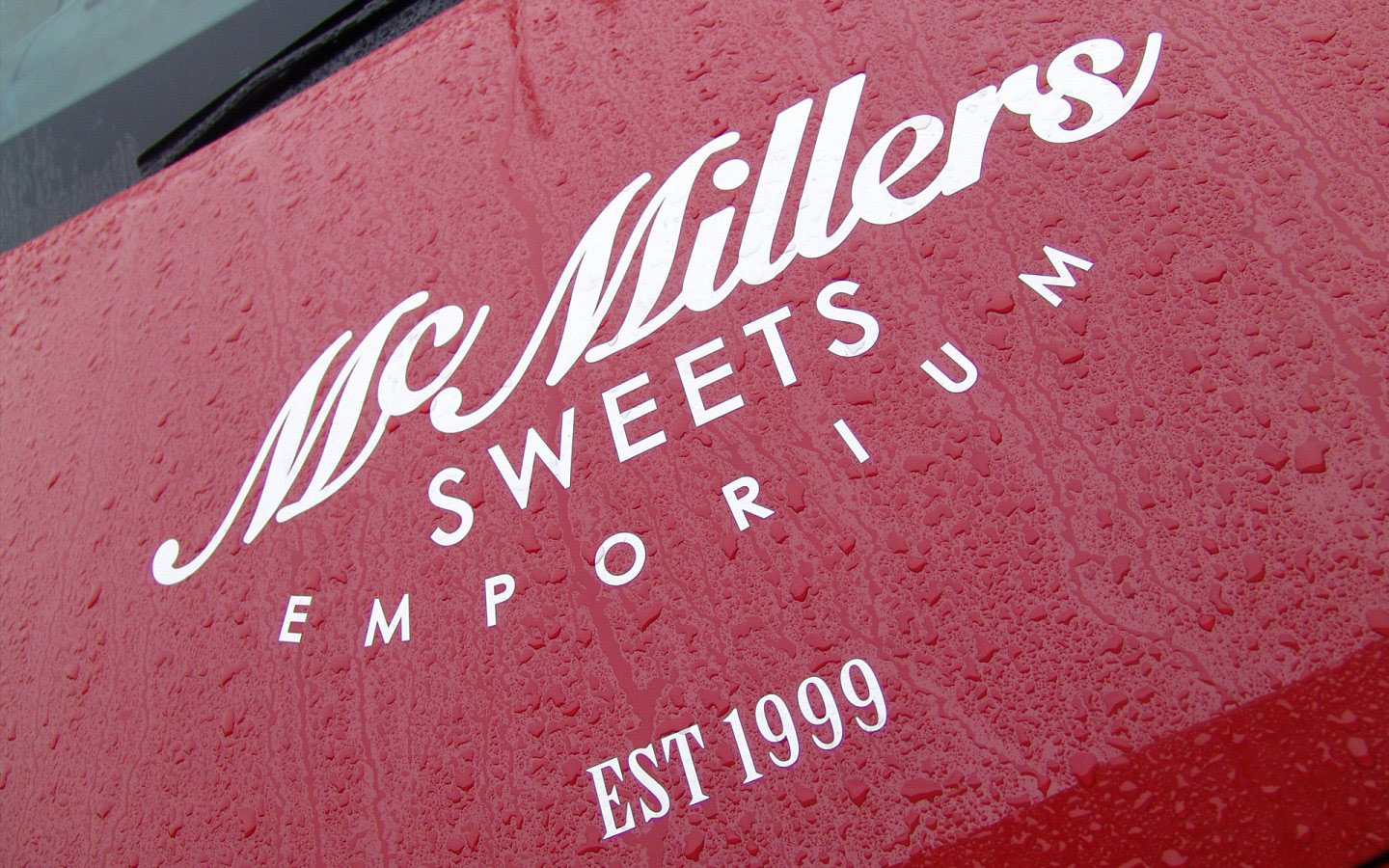 McMillers Sweets Emporium Logo Design Mono Simplified on Car